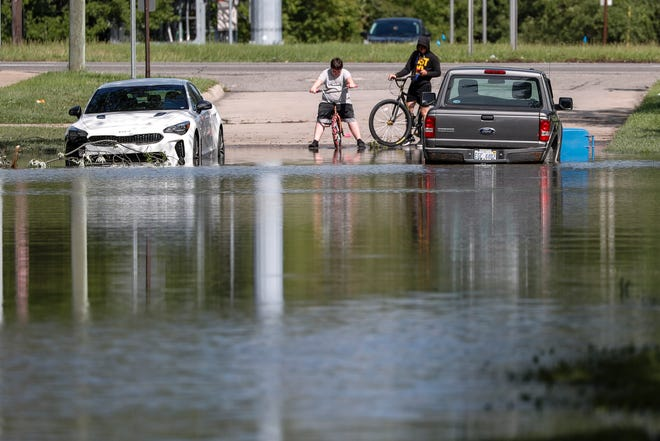 Flooding in the neighborhood by Hanover Street and Banner Street in Dearborn Heights, Thursday, August 12, 2021.