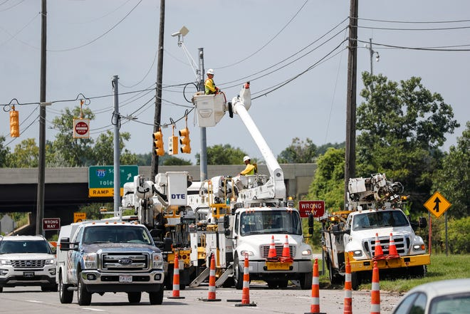 A DTE crew works on power lines on Michigan Avenue near I-275 in Canton Township on August 12, 2021.