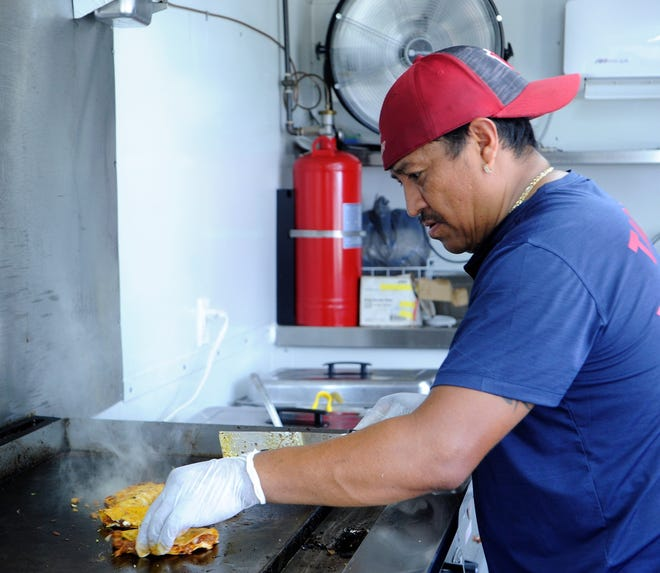 Lidio Vargas griddles tacos inside the Taqueria Vargas food truck on Wednesday, Aug. 11, 2021.