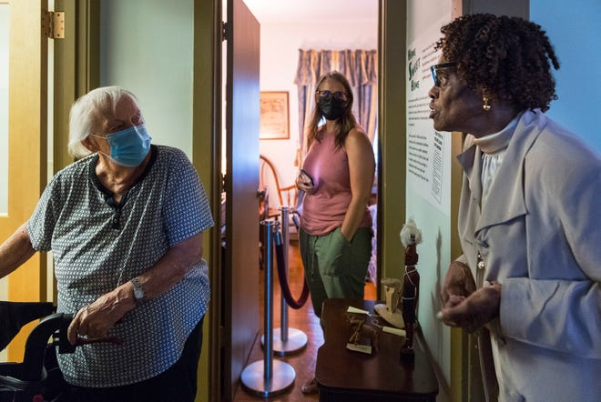Stella Eberhard, left, and Stefanie Joseph, center, of Salt Lake City, Utah, listen as Janice Hale, right, gives a guided tour of the Evansville African American Museum Tuesday afternoon, Aug. 12, 2021. Hale has worked for the museum for 14 years and grew up as a resident of Lincoln Gardens in the same building the museum now occupies.