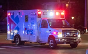 An ambulance drives toward a hospital, lights and sirens engaged, on Wednesday, Aug. 11, 2021, at the scene of an earlier shooting near the corner of 75th and N. Shadeland Ave., that reportedly resulted in at least one injury to a law enforcement officer, and possibly an unknown number of others.