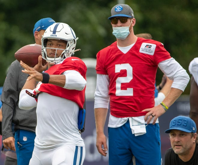 Indianapolis Colts quarterback Carson Wentz (2) watches a pass by Brett Hundley during a combined Indianapolis Colts and Carolina Panthers practice at Grand Park in Westfield on Thursday, August 12, 2021, during Colts camp.