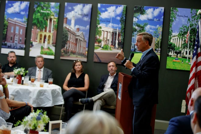Former Tennessee Governor Bill Haslam tells a story from his days serving in Nashville on Wednesday at the Southwest Tennessee Developmental District in Downtown Jackson.