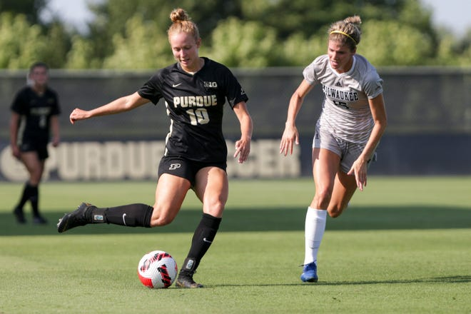 Purdue midfielder Emily Mathews (10) kicks the ball during the second half of a NCAA exhibition soccer match, Wednesday, Aug. 11, 2021 at Folk Field in West Lafayette.