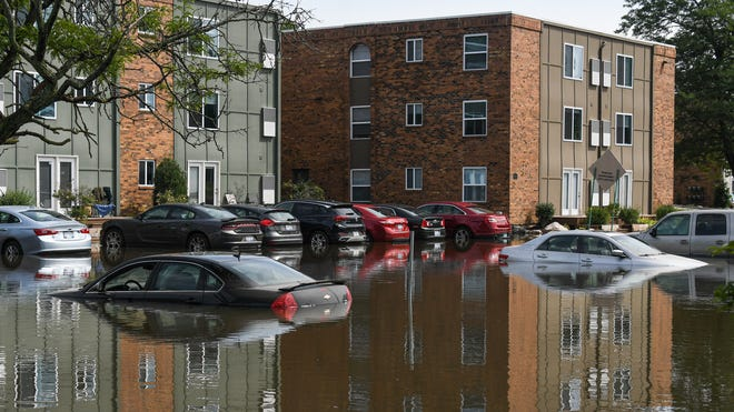 Severe storms caused flooding and power outages in the Greater Lansing area early Thursday morning, as seen at The Quarters at East Lansing apartments on the 6000 block of Abbot Road.