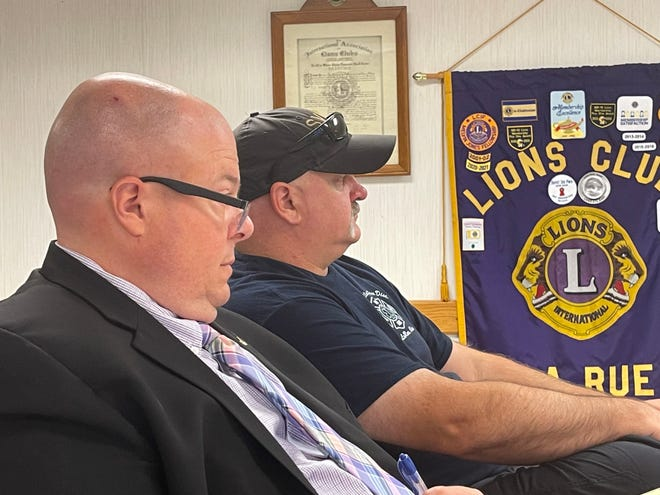 Scioto Valley Fire Chief Paul Kerr (black hat) sits with his defense attorney Porter Welch as the Scioto Valley Fire Board advised Kerr would be placed on a 30-day paid suspension after refusing to respond to a structure fire on Seiter Road on Easter morning.