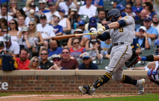 Milwaukee Brewers catcher Manny Piña was sidelined with a slight oblique strain.