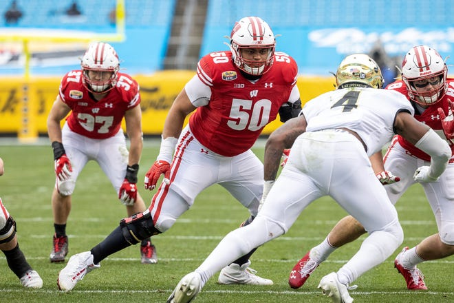 Wisconsin Badgers offensive lineman Logan Brown blocks during the Duke's Mayo Bowl against Wake Forest last season.