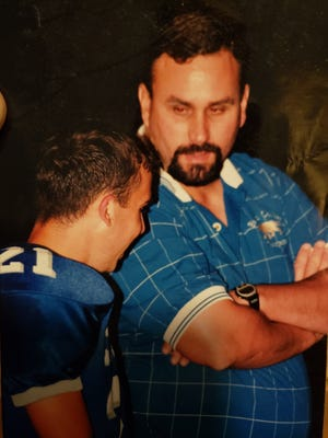 Ken Andiorio talks to a player during his time as initial football coach Barron Collier in this undated photo.  Andiorio recently retired after 27 years as coach, teacher and athletic director at Barron Collier.