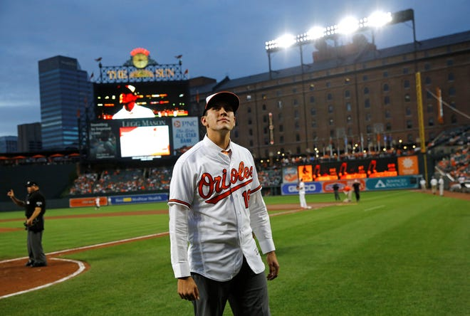 Grayson Rodriguez, the Baltimore Orioles' 2018 first round draft pick, stands on the field during a baseball game between the Orioles and the Boston Red Sox, Tuesday, June 12, 2018, in Baltimore. (AP Photo/Patrick Semansky)