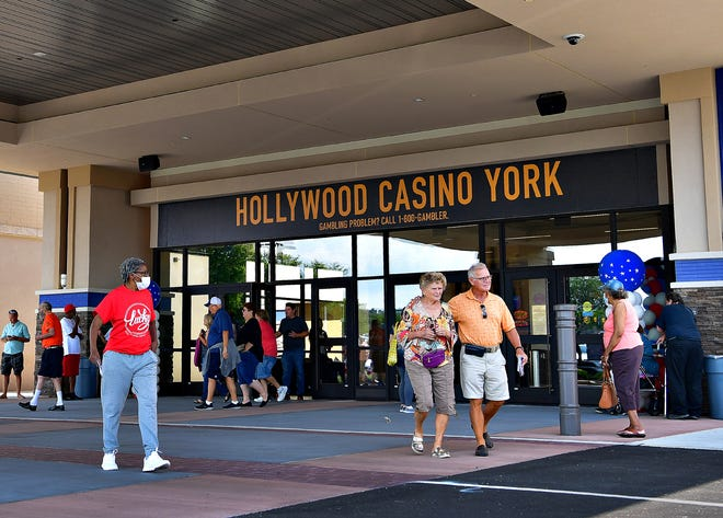 Polly Hupper, center left, and Ron DeSimone, both of York Township, walk together as they exit Hollywood Casino during its grand opening at Galleria Mall in Springettsbury Township, Thursday, Aug. 12, 2021. Dawn J. Sagert photo