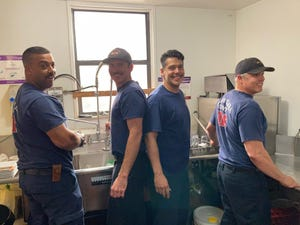 Santa Clara County firefighters Tyler Broom (left) Nathan Nazaroff (center), Miguel Brown (center) and Laynne Cooley (right) stepped in to help wash dishes after Jeffrey's Pub & Grub in Quincy became short staffed on Sunday, Aug. 1, 2021.