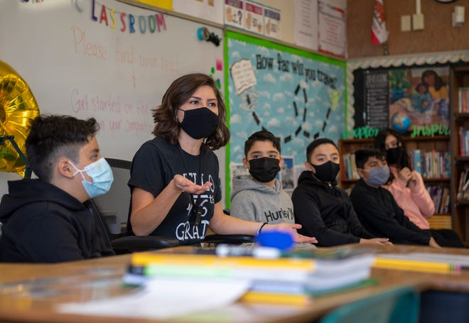 Alyse Herrera, talks to her class during a morning exercise on the first day of school at Natividad Elementary School in Salinas, Calif., on Wednesday, Aug. 11, 2021.