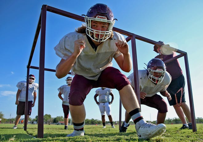 Players on the Paint Rock High School football team run through a practice drill in Paint Rock on Thursday, Aug. 12, 2021.