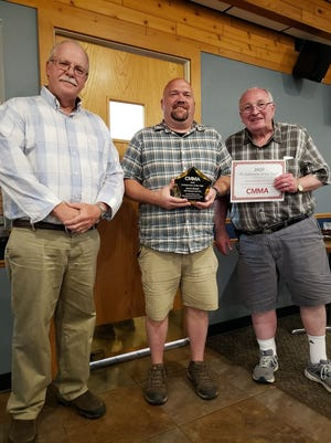 Aaron Barker of St. Cloud Community and Technical College, center, was presented the 2020 Central Minnesota Manufacturers Association 2020 Collaborator of the Year. Joining him in the photo are CMMA secretary Tim Zipoy, left, and CMMA president Les Engel, right.