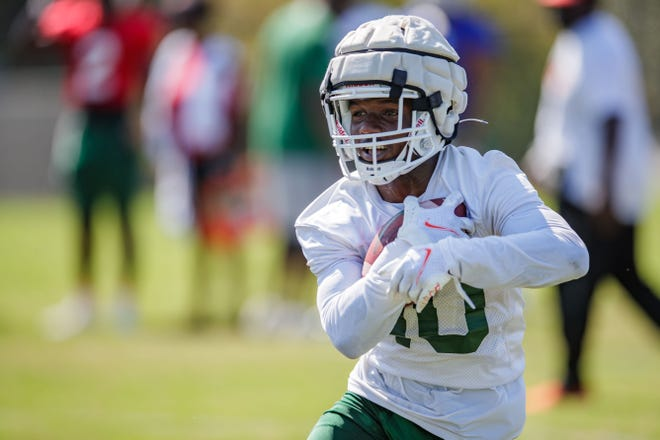 FAMU transfer wide receiver Jah'Marae Sheread runs after a catch for extra yardage during fall camp.