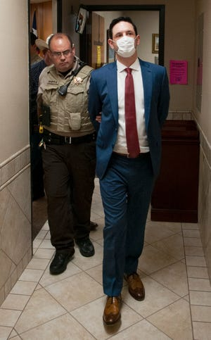 A Wichita County sheriff's deputy escorts James Irven Staley III from 89th District Court Thursday, Aug. 12, 2021.
