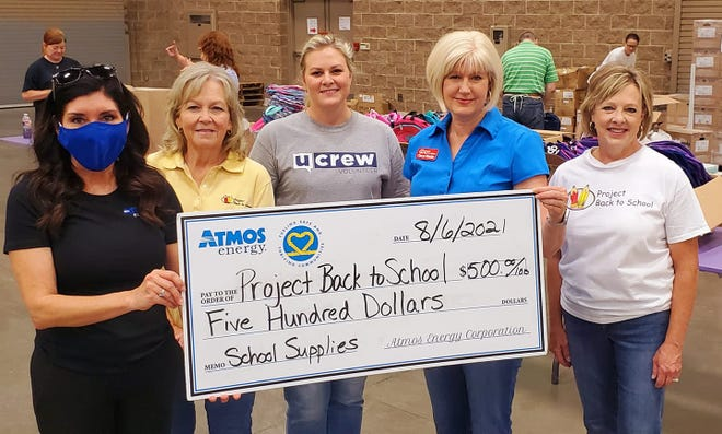 Picture from left, Pam Hughes Pak with Atmos Energy and Project Back to School's Angela Culley, Julie Wilson, Cheryl Smiley, and Vanda Cullar.
