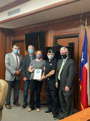 From left, Commissioner BarryMahler, Commissioner MarkBeauchamp, Kayla Fowler, Cmdr. JoelJimenez, County Judge WoodyGossom.