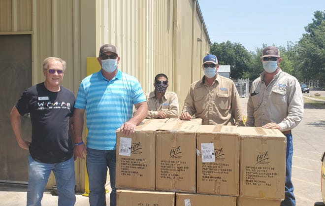 Pictured from left, Jim McMahan from the Wichita Falls Area Food Bank and Joe Greer, Edgar Rodriquez, Shawn Talley, and Carter Crain from Atmos Energy.