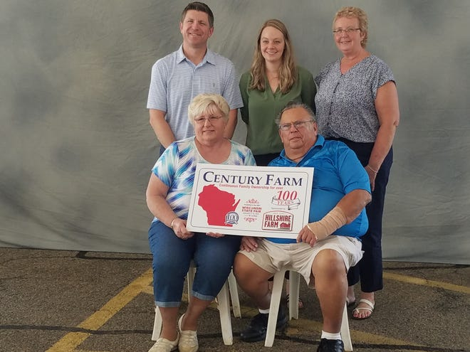 Not too many farms are left in the Cedarburg area of Wisconsin which is why the Dobberpuhl family was excited to celebrate their family's heritage and receiving the Century Farm award at the Wisconsin State Fair last week in West Allis.  Family members who took part in the celebration included Neil and Joyce, front.  In back at left is their son, Bevan, Katie Livingston who's late father Blain was a part of the farm business and his wife Julie.