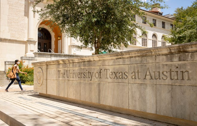 A woman wears a mask on the University of Texas campus earlier this month.