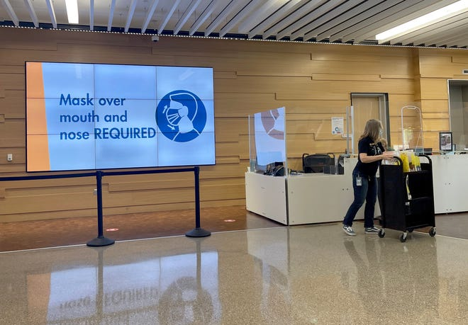 In this Aug. 13 photo, a sign at Austin Central Library requires patrons to wear a mask. Austin and Travis County officials issued orders to require masks in all county public schools, as well as in city and county buildings.