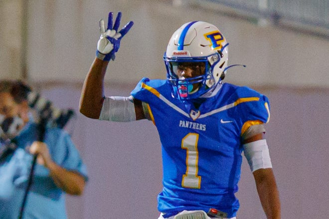 Pflugerville senior receiver Donald Springs, gesturing during a game against Manor last fall, said a playoff game against Canyon Lake is his favorite high school memory.
