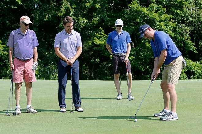 Mel Karas, Mayor Matt Miller and Conner Brittinger watch as Mike Raubenolt putts at the fourth annual Mayor's Golf Classic at Brookside Golf Course on  Aug. 13.  Nineteen teams played in the outing with all proceeds going to course operations. According to Miller, the course was running at a $175,000 annual deficit four years ago. This year, it is more than $100,000 in the black. TOM E. PUSKAR/TIMES-GAZETTE.COM
