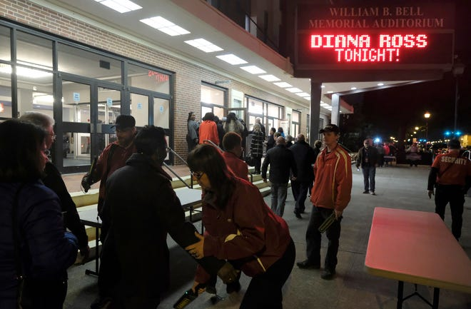 A crowd passes through security screening at Diana Ross' 2018 concert the Bell Auditorium in downtown Augusta. Fans going to The Killers concert at the Bell Auditorium will need to show proof of COVID vaccination and a negative COVID test taken within 48 hours before entering the venue.