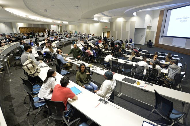 Medical students attend class on a February morning in 2019 inside an auditorium that can accommodate 300 people in the Harrison Education Commons building at Augusta University.