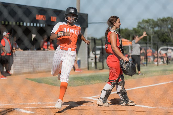 Pawhuska Lady Huskies score a run in the first home game of the season against Pawnee on Thursday.