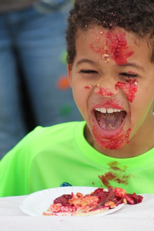 At kids' day at the Cheboygan County Fair, children of different age groups competed against each other to see who could eat a slice of pie faster than all the other children their age. The winners were all given a gift card to get a free ice cream cone from McDonald's.