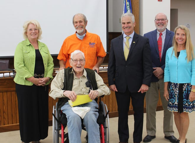 World War II bomber pilot Richard Gillespie (seated) was honored Monday, Aug. 9 at the meeting of the Yates County Legislature for his 100th birthday and in recognition of his service to a grateful nation. With him are Legislator Leslie Church, his son Bob, Yates County Veterans' Services Director Phil Rouin, Legislature Chairman Doug Paddock, and County Treasurer/Administrator Nonie Flynn.