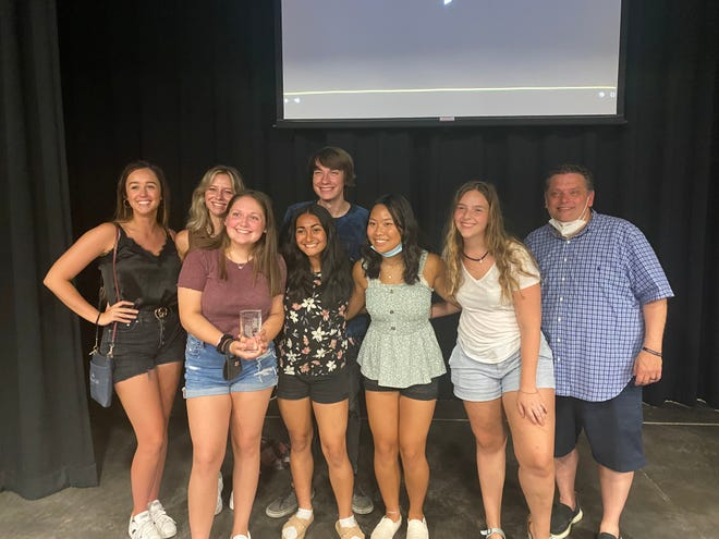 Gahanna Lincoln High School television program nominees, who gathered during a July 25 virtual awards ceremony, include (front row, from left) Audrey Paquette, Rei Tedoco, Lily Sager, Abi Figurski, (back row) Reese Thompson, Caroline Mattox, Wesley Triplett and adviser Mark Lowrie. Lowie said Paquette is holding a crystal pillar from a previous year. The program won seven student-production Emmy Awards, more than any other school in Ohio.