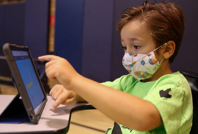 Max Callif, 5, works on an iPad during the Kindergarten Academy on Aug. 11 at Stevenson Elementary School.