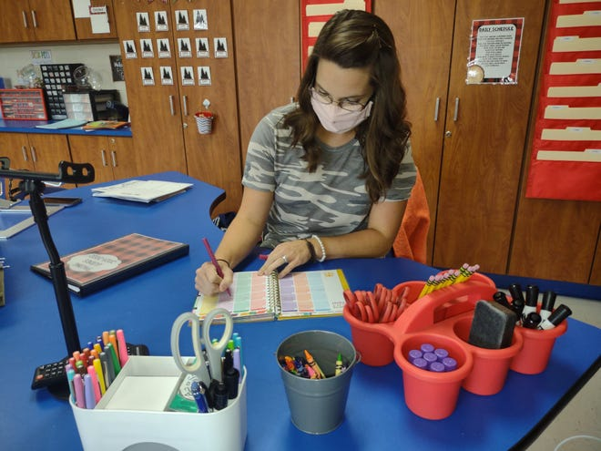 Heather Hall, a first-grade teacher at Charles England Elementary School, looks forward to having students back in the classroom as she prepares for another academic year.