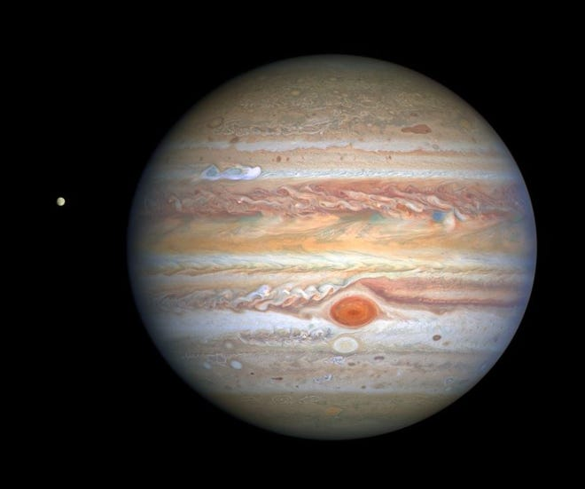 Planet Jupiter and its moon Europa at left, photographed by the Hubble Space Telescope, August 20, 2020. NASA, ESA, STScI image.