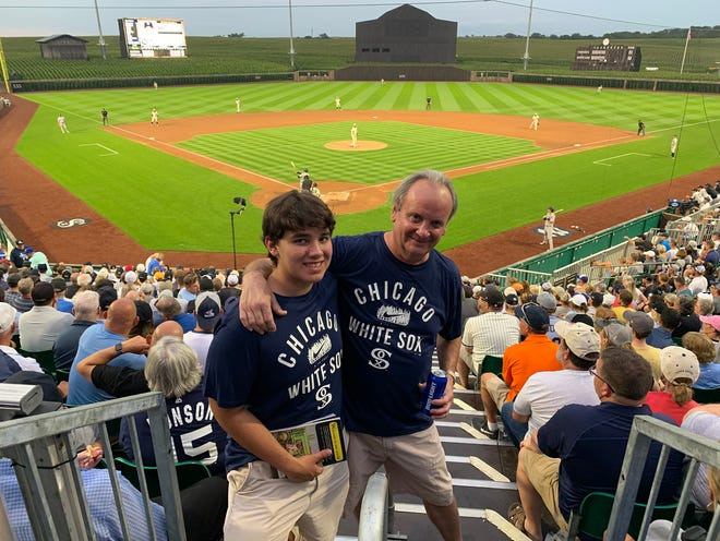 Brent Bernett and his son Clark Bernett, both of Galesburg, attended the MLB Field of Dreams Game on Thursday in Dyersville, Iowa.