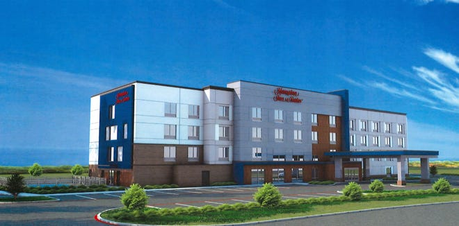 An artist rendering shows plans for a proposed Hampton Inn & Suites along Cornerstone Drive in Sherman.