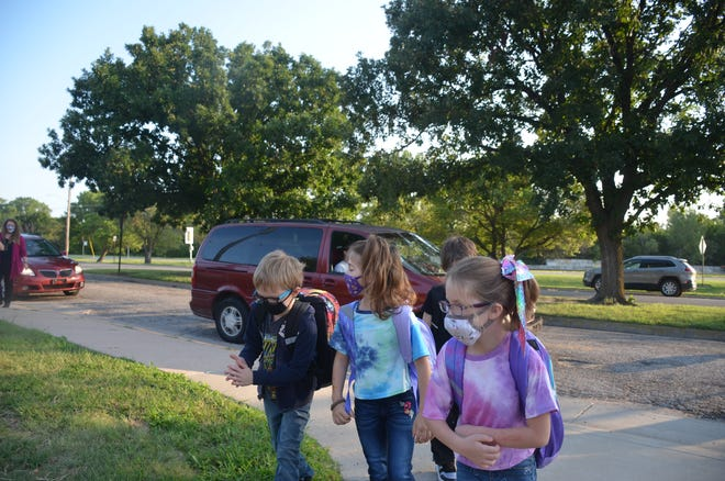 Students make their way into Northridge Elementary for the first day of school Aug. 12.