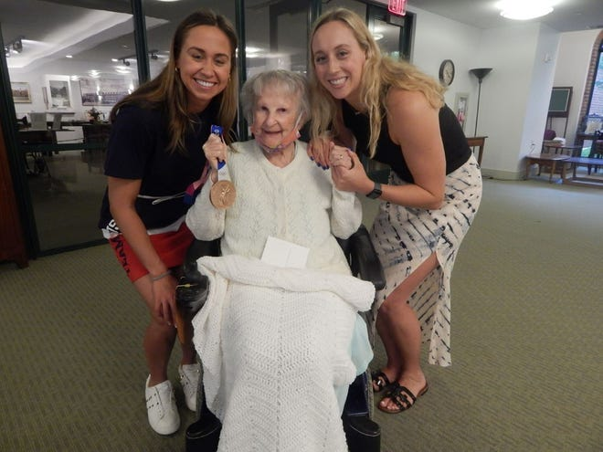 The DeLoof sisters pose for a picture with Sister Annette Boyle.