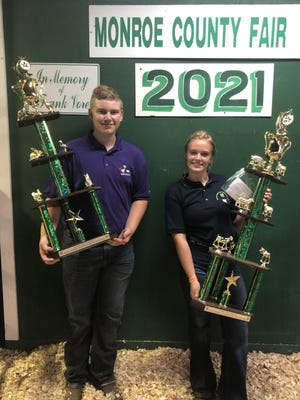 Brandon Fisher of Lambertville and Sydney Linn of Carleton were picked the best 4-H showmen of small and large animals, respectively, at the Monroe County Fair last week.