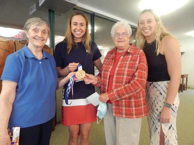 Catie DeLoof (with medal) stands with Sister Anne Crane (left) and Sister Joyce Durosko. Catie's sister, Gabby, is on the right. Photos courtesy of IHM