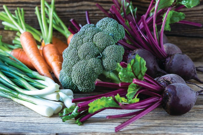 Fall produce includes vegetables such as carrots, beetroots, broccoli, and green onions.