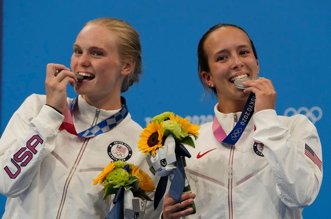 Jessica Parratto, right, and Delaney Schnell of the United States' pose for a photo after winning silver medals during the women's synchronized 10m platform diving final at the Tokyo Aquatics Centre at the 2020 Summer Olympics, Tuesday, July 27, 2021, in Tokyo, Japan.