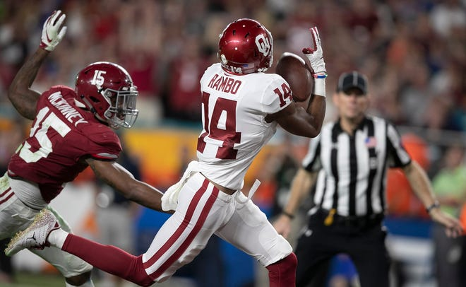 Oklahoma wide receiver Charleston Rambo (14) catches a touchdown pass against Alabama in the 2018 College Football Playoff semifinals at Hard Rock Stadium in Miami Gardens. [ALLEN EYESTONE/palmbeachpost.com]