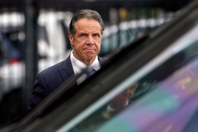 New York Gov. Andrew Cuomo prepares to board a helicopter after announcing his resignation in New York earlier this month.