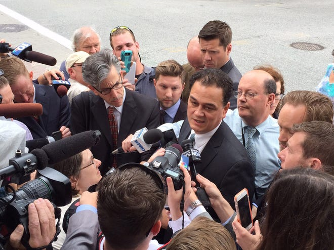 Fox1--Providence, RI. Thursday, June 11, 2015. Gordon Fox talks to the media outside the Federal Courthouse after his sentencing on corruption charges. Providence Journal/Kathy Borchers