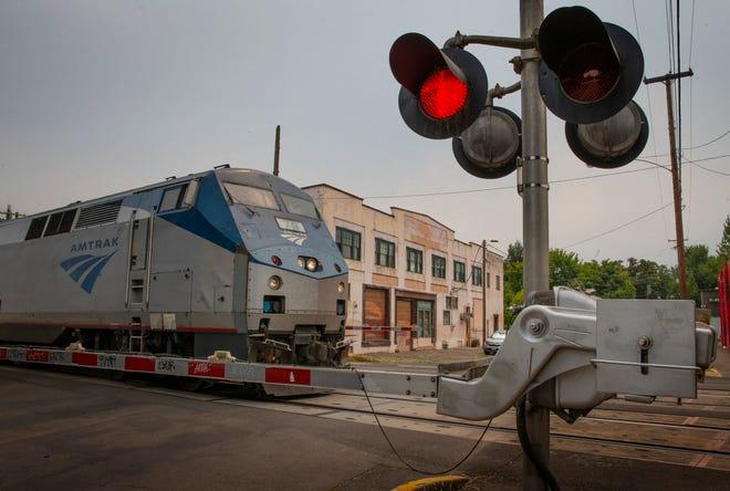 An Amtrak train rolls through Eugene through Lawrence Street.